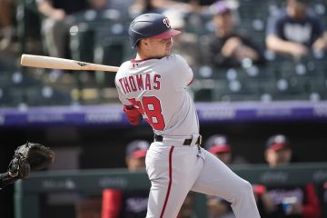 Nationals Outfielder Lane Thomas takes a cut